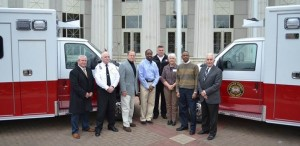 Left to Right:  County Administrator Mark Teal; Fire/EMS Chief Scott Spencer; District 3 Commissioner Mike Mulcare; District 1 Commissioner Henry Mitchell III; Deputy Fire/EMS Chief Scott Zachmeyer; District 4 Commissioner Ann Jones Guider; District 2 Commissioner Kelly Robinson; Commission Chairman Tom Worthan - with the 2 new ambulances/rescue units in front of the Douglas County Courthouse