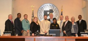 Left to Right:  County Administrator Mark Teal, District 1 Commissioner Henry Mitchell III, honoree Nathan Robinson, honoree Heather Rice, Boundary Waters Aquatic Center Manager Jim Gay, Parks and Recreation Director Gary Dukes, Parks Security Manager Chesity Hurston, District 3 Commissioner Mike Mulcare, Chairman Tom Worthan, District 4 Commissioner Ann Jones Guider, District 2 Commissioner Kelly Robinson (honoree Sam Roton was unable to be present)