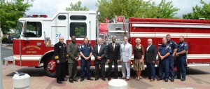 Fire Chief Scott Spencer, firefighters from Station No. 1, and the Douglas County Board of Commissioners with the new 2016 pumper