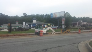 Construction crews working on new left turn into Lakeside at Arbor Place Apartments