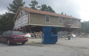 The old house next to the Marathon in the process of being demolished.