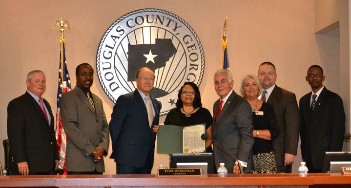 S.H.A.R.E. House Executive Director Teresa Smith and District Attorney Brian Fortner with the Douglas County Board of Commissioners and County Administrator
